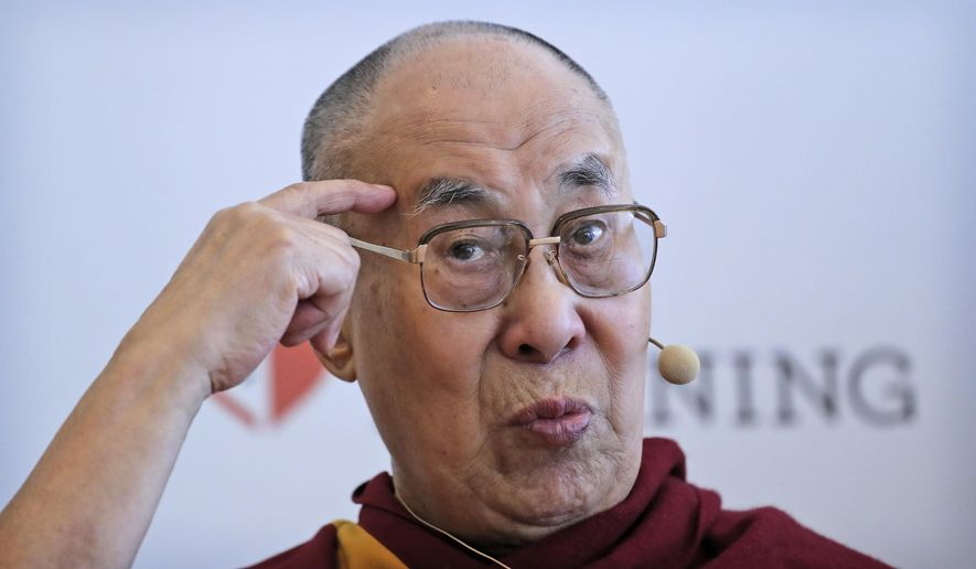 """Tibetan spiritual leader the Dalai Lama speaks during a press conference after talking to an audience of educators, in New Delhi, India, Thursday, April 4, 2019. The Dalai Lama says he has been seeking a mutually acceptable solution to the Tibetan issue with China since 1974 but that Beijing considers him a """"splittist.""""(AP Photo/Manish Swarup)"""