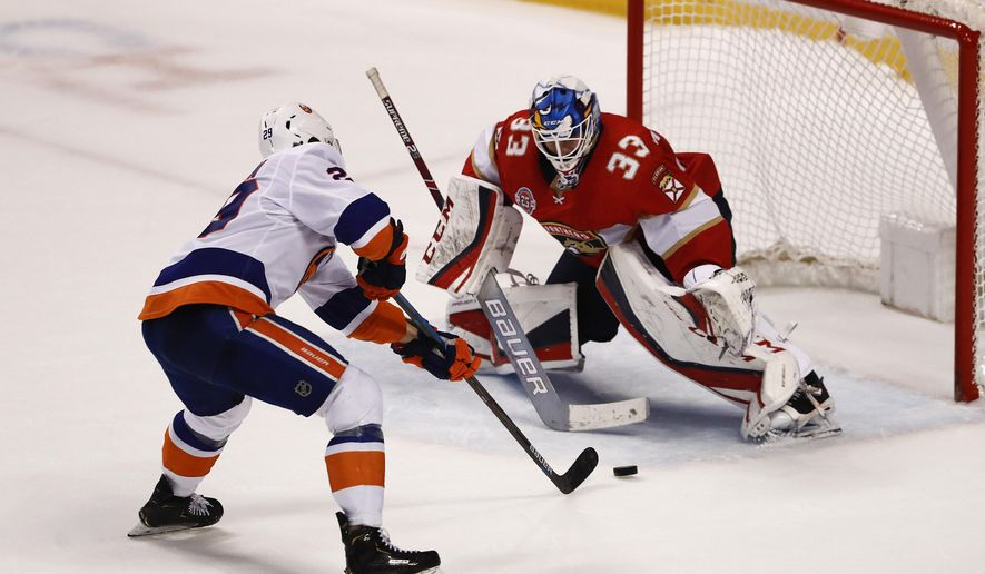 New York Islanders center Brock Nelson (29) shoots and scores against the Florida Panthers goaltender Samuel Montembeault (33) during a shootout of an NHL hockey game on Thursday, April 4, 2019, in Sunrise, Fla. (AP Photo/Brynn Anderson)