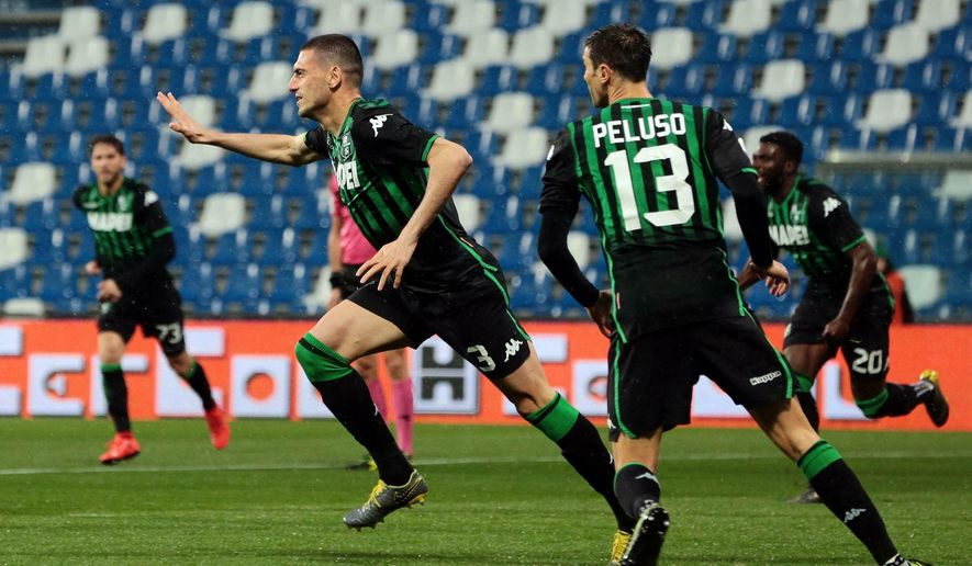 Sassuolo's Merih Demiral celebrates with his teammates after scoring his team's first goal during the Italian Serie A soccer match between Sassuolo and Chievo Verona at Mapei Stadium in Reggio Emilia, Italy, Thursday, April 4, 2019. (Elisabetta Baracchi/ANSA via AP)