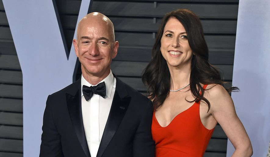 In this March 4, 2018 file photo, Jeff Bezos and wife MacKenzie Bezos arrive at the Vanity Fair Oscar Party in Beverly Hills, Calif. Jeff Bezos and MacKenzie, announced Thursday, April 4, 2019, in a series of tweets that they have finalized their divorce, ending a 25-year marriage that played a role in the creation of the online shopping giant. (Photo by Evan Agostini/Invision/AP, File) **FILE**
