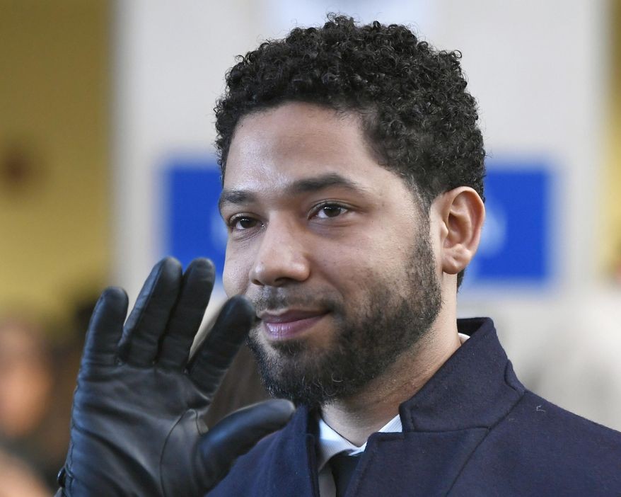 In this March 26, 2019, file photo, actor Jussie Smollett smiles and waves to supporters before leaving Cook County Court after his charges were dropped in Chicago.  (AP Photo/Paul Beaty, File) **FILE**