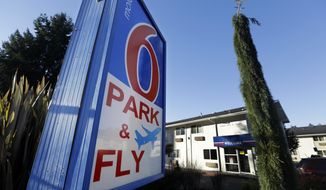 FILE - This Jan. 3, 2018 file photo shows a Motel 6 in SeaTac, Wash. The national chain Motel 6 agreed Thursday, April 4, 2019, to pay $12 million to settle a lawsuit filed by Washington state claiming names of hotel guests were provided to immigration officials for two years, according to Attorney General Bob Ferguson. (AP Photo/Elaine Thompson, File)