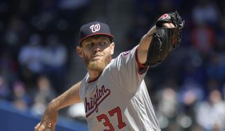 Washington Nationals starting pitcher Stephen Strasburg throws to the New York Mets during the first inning of a baseball game, Thursday, April 4, 2019, in New York. (AP Photo/Bill Kostroun)