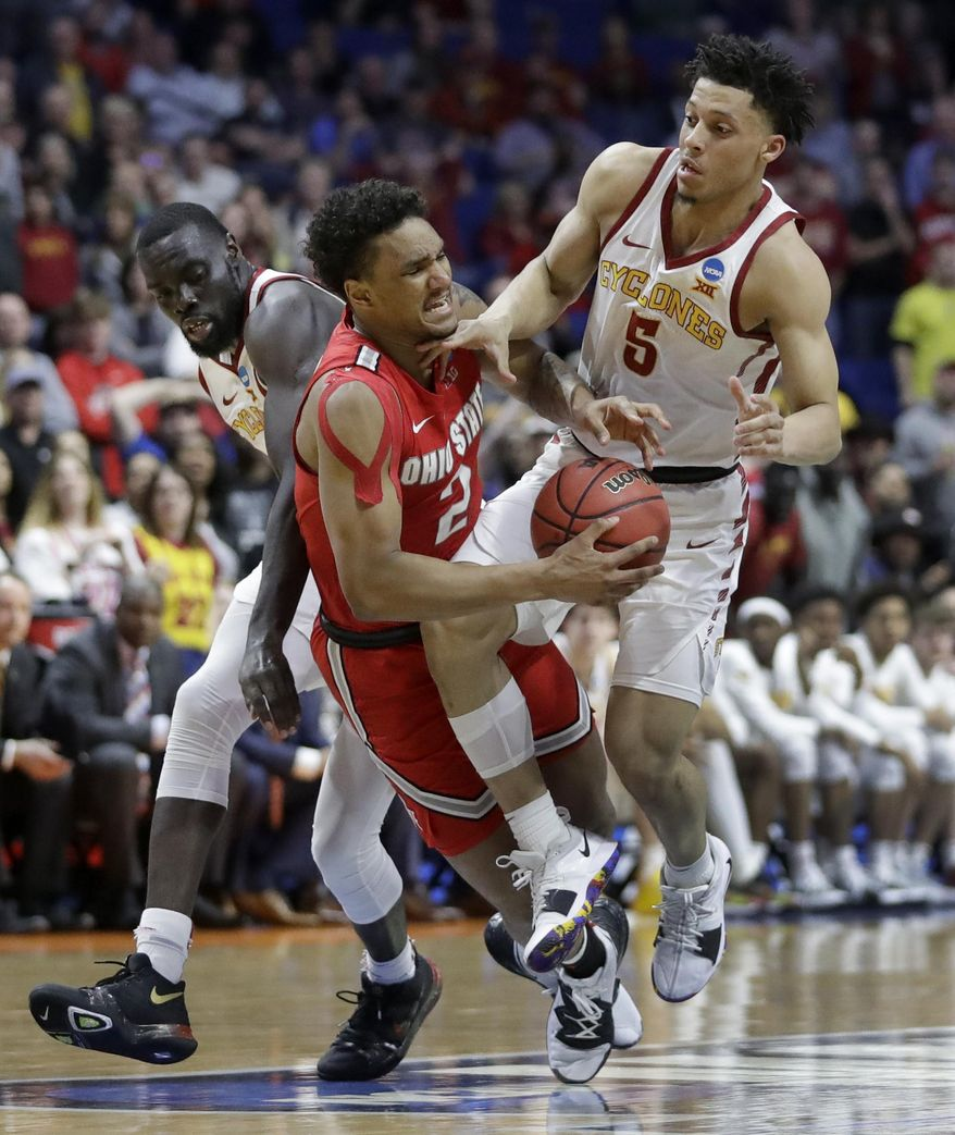 Ohio State's Musa Jallow (2) collides with Iowa State's Marial Shayok, left, and Lindell Wigginton (5) during the second half of a first round men's college basketball game in the NCAA Tournament Friday, March 22, 2019, in Tulsa, Okla. Ohio State won 62-59. (AP Photo/Jeff Roberson)