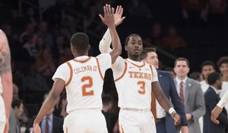 Texas guard Matt Coleman III (2) and guard Courtney Ramey (3) celebrate during the first half of a final college basketball game in the National Invitational Tournament against the Lipscomb, Thursday, April 4, 2019, at Madison Square Garden in New York. (AP Photo/Mary Altaffer)
