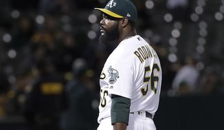 Oakland Athletics pitcher Fernando Rodney walks toward the dugout after being removed during the ninth inning of the team's baseball game against the Boston Red Sox in Oakland, Calif., Wednesday, April 3, 2019. (AP Photo/Jeff Chiu)