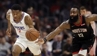 Los Angeles Clippers' Shai Gilgeous-Alexander, left, dribbles past Houston Rockets' James Harden (13) during the first half of an NBA basketball game Wednesday, April 3, 2019, in Los Angeles. (AP Photo/Marcio Jose Sanchez)