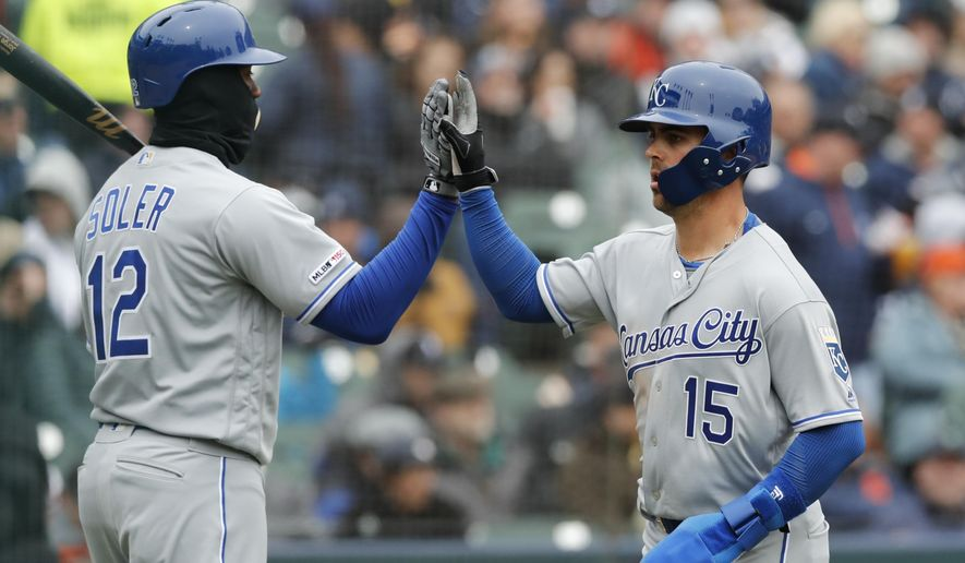 Kansas City Royals' Whit Merrifield (15) scores on a sacrifice fly to left by teammate Alex Gordon during the fifth inning of a baseball game against the Detroit Tigers, Thursday, April 4, 2019, in Detroit. (AP Photo/Carlos Osorio)