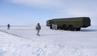 In this photo taken on Wednesday, April 3, 2019, Russian troops conduct training with a Bastion missile launcher on Kotelny Island, part of the New Siberian Islands archipelago located between the Laptev Sea and the East Siberian Sea, Russia. Russia has made reaffirming its presence in the Arctic the top goal amid an intensifying international rivalry over the region that is believed to hold up to one-quarter of the planet's undiscovered oil and gas. (AP Photo/Vladimir Isachenkov)