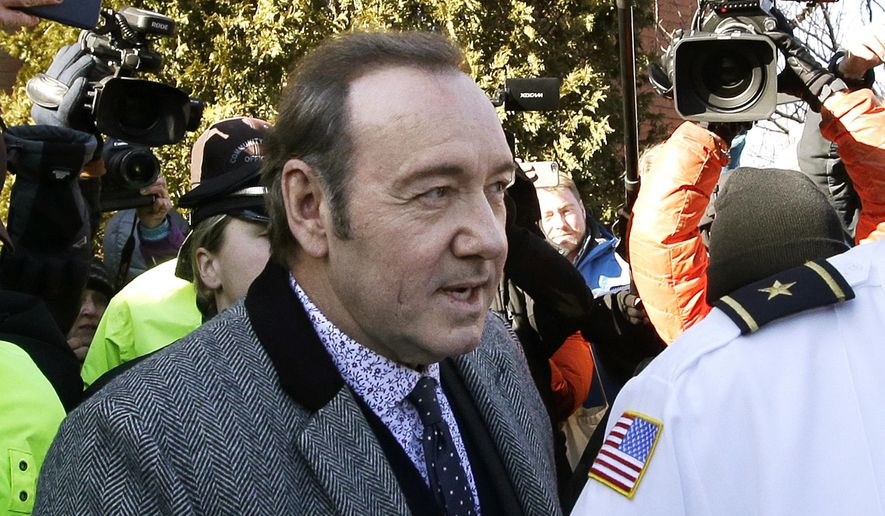 FILE - In this Jan. 7, 2019 file photo, actor Kevin Spacey departs from district court after arraignment on a charge of indecent assault and battery in Nantucket, Mass. On Thursday, April 4, 2019, a judge at Nantucket District Court will consider motions filed by lawyers for Spacey, charged with groping an 18-year-old man on Nantucket in 2016. The Oscar-winning actor will not be present for the hearing. (AP Photo/Steven Senne, File)