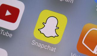 This Aug. 9, 2017, file photo shows the Snapchat app on a mobile device in New York. (AP Photo/Richard Drew, File) **FILE**