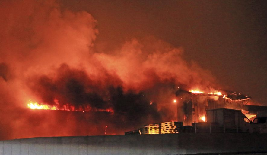In this Thursday, April 4, 2019, photo, a house burns in Goseong, South Korea. The fire likely started Thursday night from a transformer spark near a resort in the town of Goseong in Gangwon province about 210 kilometers (130 miles) northeast of Seoul and then spread to the nearby mountains, according to Choi Jin-ho, a fire captain at Gangwon Fire Headquarters. (Lee Jong-geun/Yonhap via AP)