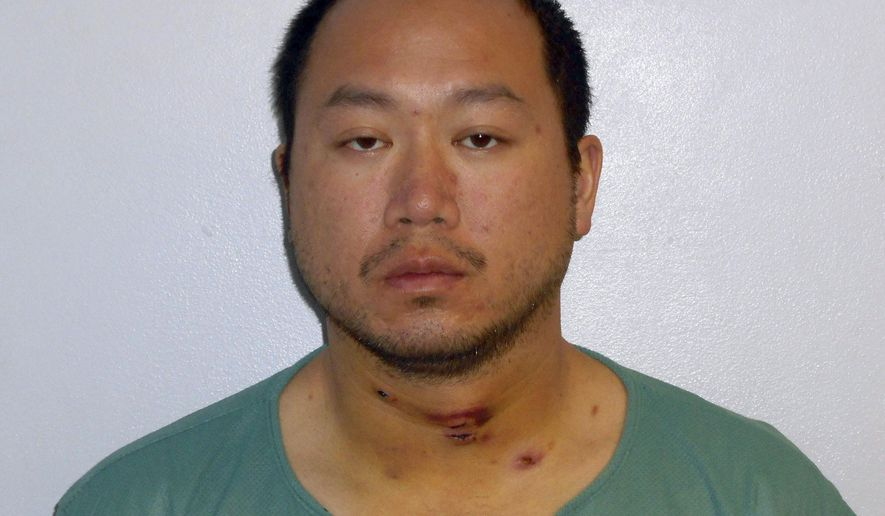 """This booking photo released Thursday, April 4, 2019, by the Concord Police Department shows Primo """"Howie"""" Leung, a high school teacher who has been arrested on a fugitive from justice charge in connection with sexual assault allegations involving a minor in Massachusetts. (Concord Police Department via AP)"""