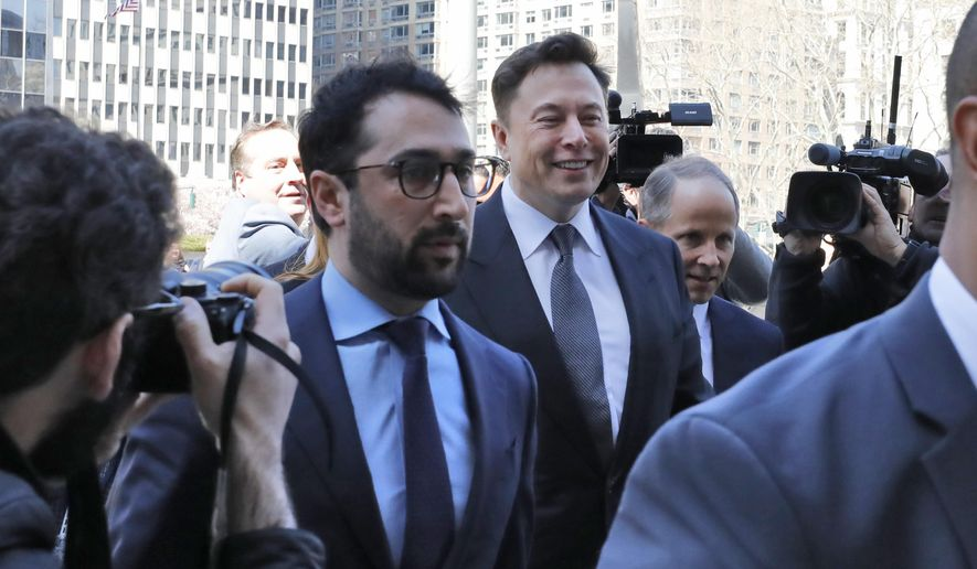 Tesla CEO Elon Musk, center, arrives at Manhattan Federal Court, in New York, Thursday, April 4, 2019. Musk and his lawyers were appearing before a federal judge in New York who will decide whether the Tesla CEO should be held in contempt of court for violating an agreement with the U.S. Securities and Exchange Commission.(AP Photo/Richard Drew)