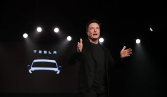 In this March 14, 2019, file photo Tesla CEO Elon Musk speaks before unveiling the Model Y at Tesla's design studio in Hawthorne, Calif. A federal judge will hear oral arguments Thursday, April 4, about whether Tesla CEO Elon Musk should be held in contempt of court for violating an agreement with the U.S. Securities and Exchange Commission.(AP Photo/Jae C. Hong, File)