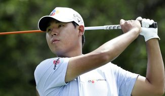 Si Woo Kim watches his drive on the ninth hole during the first round of the Texas Open golf tournament, Thursday, April 4, 2019, in San Antonio. (AP Photo/Eric Gay)