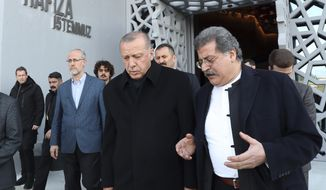 Turkey's President Recep Tayyip Erdogan, center, in a first public appearance after Sunday elections in Istanbul, Thursday, April 4, 2019, listens as he visits an uncompleted museum dedicated to the July 15, 2015 coup attempt. Erdogan's ruling party is appealing the results of the local elections in Istanbul, where the opposition has a razor-thin lead. (Presidential Press Service via AP, Pool)