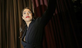 Rep. Alexandria Ocasio-Cortez, D-N.Y., arrives on the stage before speaking during the National Action Network Convention in New York, Friday, April 5, 2019. (AP Photo/Seth Wenig)