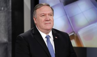"""U.S. Secretary of State Mike Pompeo appears on the """"Mornings with Maria Bartiromo"""" program on the Fox Business Network, in New York Friday, April 5, 2019. (AP Photo/Richard Drew)"""