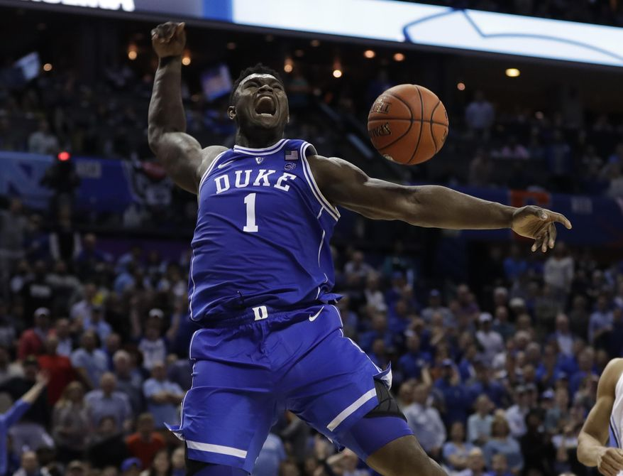 In this March 15, 2019, file photo, Duke's Zion Williamson reacts after his dunk against North Carolina during the second half of an NCAA college basketball game in the Atlantic Coast Conference tournament, in Charlotte, N.C. Williamson was named The Associated Press Player of the Year, Friday, April 5, 2019. (AP Photo/Nell Redmond, File) **FILE**