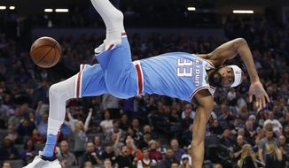 Sacramento Kings guard Corey Brewer falls to the court after a dunk during the first quarter of the team's NBA basketball game against the Cleveland Cavaliers on Thursday, April 4, 2019, in Sacramento, Calif. (AP Photo/Rich Pedroncelli)