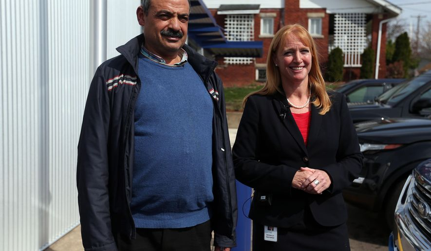 Mohamed Fathy Hussein Zayan and attorney Michelle Protzman speak during a news  conference Thursday, April 4, 2019, at the Barboursville Police Department in Barboursville, W.Va.   A charge is being dismissed against Mohamed Fathy Hussein Zayan,  who was arrested after a woman told police that he tried to abduct her young daughter but later said she might have been overreacting, a prosecutor said Thursday.Cabell County Prosecutor Corky Hammers said an attempted abduction charge will be dropped against Mohamed Fathy Hussein Zayan, who was arrested Monday at the Huntington Mall food court in Barboursville.  (Lori Wolfe/The Herald-Dispatch via AP)