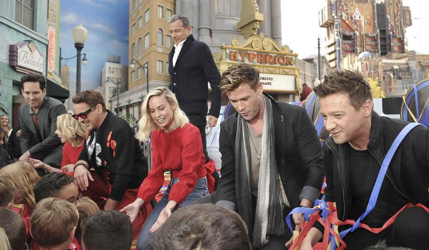 """""""Avengers: Endgame"""" cast member, Paul Rudd, foreground from left, Scarlett Johansson, Robert Downey Jr., Brie Larson, Chris Hemsworth and Jeremy Renner appear with Disney CEO, Robert Iger,, background center, at an event announcing the Universe Unites Charity at Disney California Adventure Park on Friday, April 5, 2019, in Anaheim, Calif. (Photo by Richard Shotwell/Invision/AP)"""