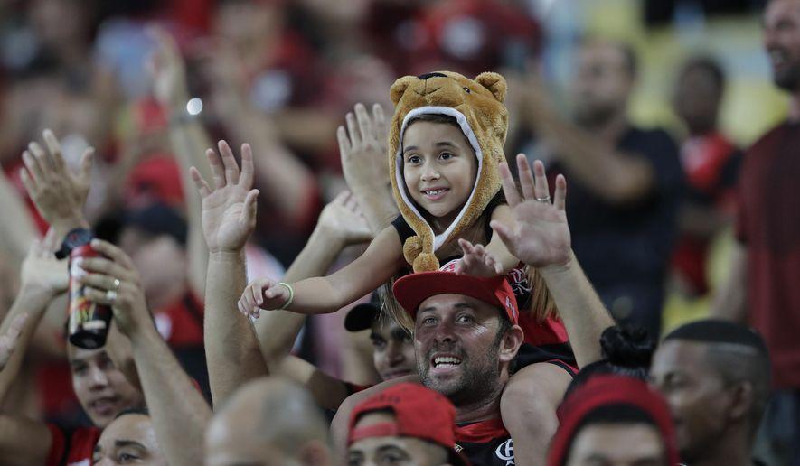 Fans of Brazil's Flamengo soccer team cheer before a Copa Libertadores soccer match against Uruguay's Penarol at Maracana stadium in Rio de Janeiro, Brazil, Wednesday, April 3, 2019. (AP Photo/Silvia Izquierdo)