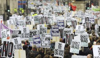 FILE - In this Feb. 15, 2003 file photo, anti-war protesters pack London's Whitehall during a march to demonstrate against a possible war against Iraq. The tumult was one of the great crises to afflict Britain in the postwar period, the latest of which relates to the country's struggles to leave the European Union. (AP Photo/Alastair Grant, File)