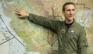 """FILE - In this April 12, 2006, file photo, then US Air Force Lt. Col. Clay """"Slam"""" Garrison, Weapons Officer assigned with the 144th Fighter Wing of the California Air National Guard, explains the units area of coverage on a map of California in Fresno, Calif. The California Air National Guard says its top commander, Major General Clay Garrison, has been relieved of command and will be replaced by Brigadier General Gregory Jones. A guard spokesman on Friday, April 5, 2019, confirmed the shakeup, but did not have additional details. (AP Photo/Ben Margot, File)"""