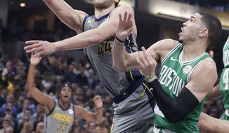 Indiana Pacers forward Bojan Bogdanovic (44) shoots over Boston Celtics forward Jayson Tatum (0) during the first half of an NBA basketball game in Indianapolis, Friday, April 5, 2019. (AP Photo/Michael Conroy)