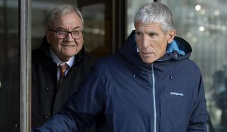 "In this March 12, 2019, file photo, William ""Rick"" Singer, front, founder of the Edge College & Career Network, exits federal court in Boston after he pleaded guilty to charges in a nationwide college admissions bribery scandal, where ringers were hired to take SAT tests and proctors paid to look the other way. The scandal is fueling deeper concerns about the fairness of using SAT and ACT tests to determine college admission. (AP Photo/Steven Senne)"