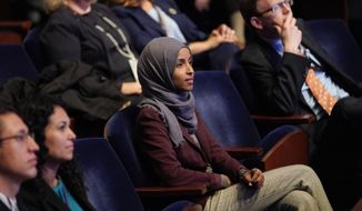 In this Nov. 15, 2018 file photo, Rep.-elect IIhan Omar, D-Minn., center, listens during member-elect orientations on Capitol Hill in Washington. (AP Photo/Pablo Martinez Monsivais, File)