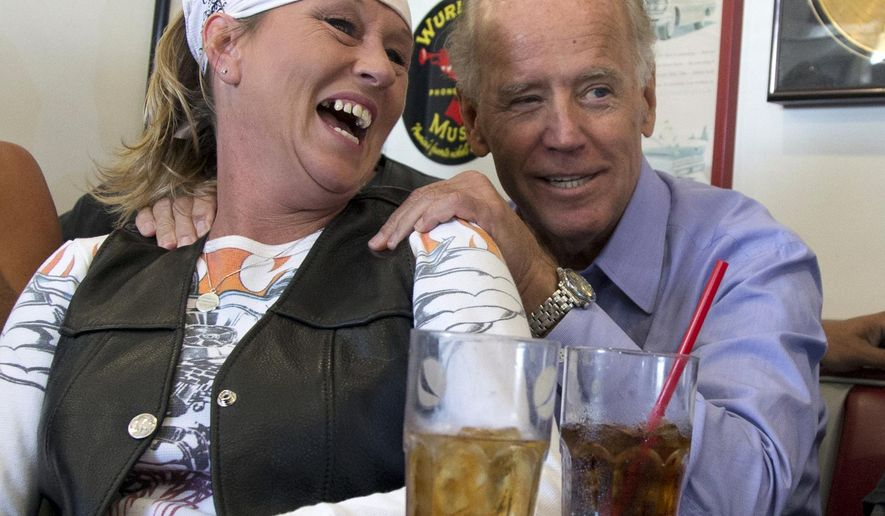 FILE - In this Sept. 9, 2012, photo, then-Vice President Joe Biden visits with patrons over lunch at Cruisers Diner in Seaman, Ohio. Biden buddied up with bikers, posed for countless pictures at a pizza place and downed an ice cream cone at a Dairy Queen over the weekend as he toured Ohio. Biden loves Ohio. (AP Photo/Carolyn Kaster, File)