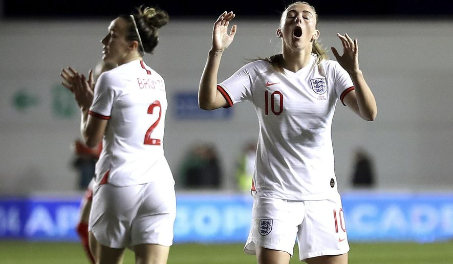 England's Toni Duggan, right, reacts after a missed chance during an international friendly soccer match against Canada at the Academy Stadium, Friday April 5, 2019, in Manchester. Canada won 1-0. (Martin Rickett/PA via AP)