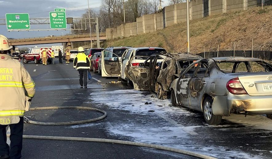 In this Thursday, April 4, 2019 photo, provided by Virginia State Police, emergency personnel work at the scene of multi-vehicle crash along the eastbound lanes of Interstate 66 near Exit 60 in Fairfax, Va. There was only one minor injury and that driver was treated at the scene, police said. (Virginia State Police via AP)