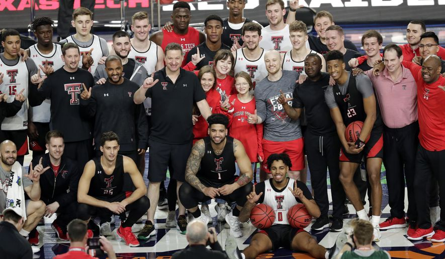 Members of Texas Tech basketball team pose for a photo during a practice session for the semifinals of the Final Four NCAA college basketball tournament, Friday, April 5, 2019, in Minneapolis. (AP Photo/Matt York)