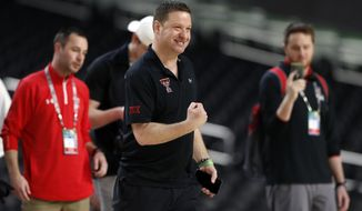 Texas Tech head coach Chris Beard pumps his fist during a practice session for the semifinals of the Final Four NCAA college basketball tournament, Friday, April 5, 2019, in Minneapolis. (AP Photo/Jeff Roberson)