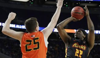 College of Charleston's Jarrell Brantley shoots over Northern Kentucky's Drew McDonald (25) during the College All-Star game the Final Four NCAA college basketball tournament, Friday, April 5, 2019, in Minneapolis. (AP Photo/David J. Phillip)