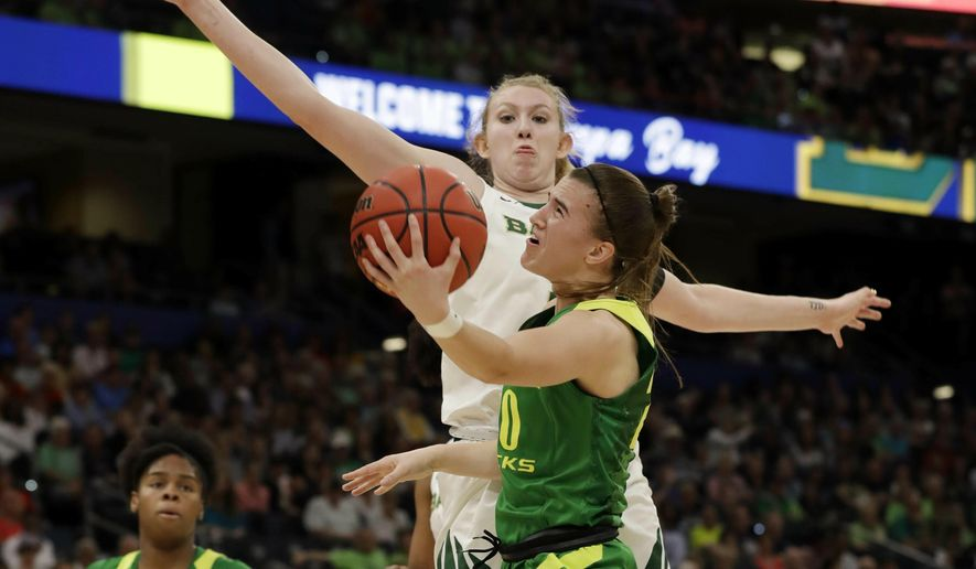 Oregon guard Sabrina Ionescu (20) drives to the basket as Baylor forward Lauren Cox (15), defends during a women's Final Four NCAA college basketball semifinal tournament game Friday, April 5, 2019, in Tampa, Fla. (AP Photo/Chris O'Meara)