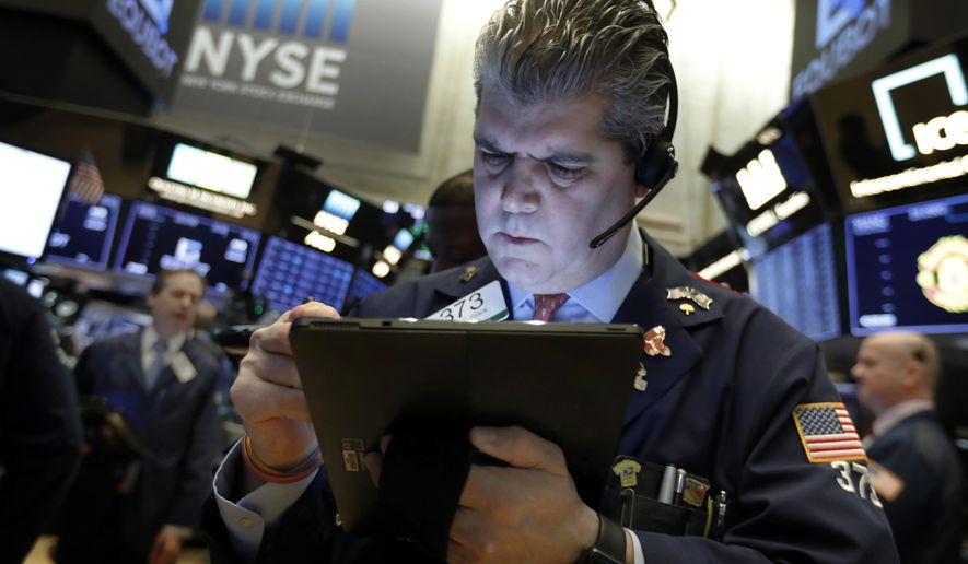 FILE- In this Feb. 5, 2019, file photo trader John Panin works on the floor of the New York Stock Exchange. The U.S. stock market opens at 9:30 a.m. EDT on Friday, April 5. (AP Photo/Richard Drew, File)