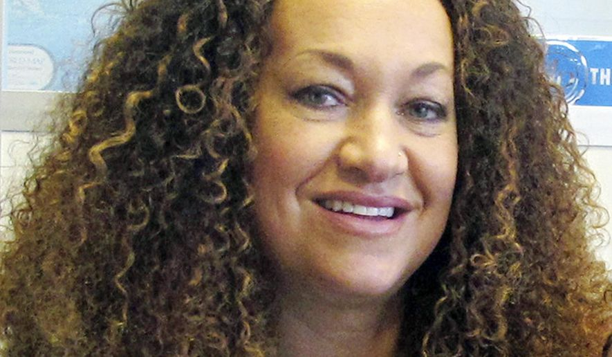 FILE - In this March 20, 2017, file photo, Nkechi Diallo, then known as Rachel Dolezal, poses for a photo in Spokane, Wash. The former NAACP leader in Washington state whose life unraveled in 2015 after she was exposed as a white woman pretending to be black has reached an agreement to avoid trial on charges of welfare fraud. Dolezal, who changed her name to Nkechi Diallo two years ago, was charged with two felonies last May. (AP Photo/Nicholas K. Geranios, File)