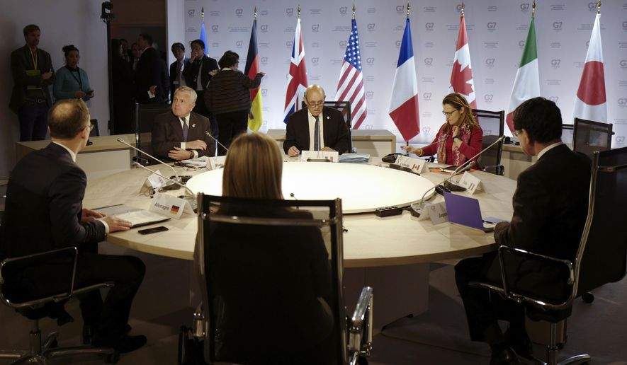 From left to right, Germany's Foreign Minister Heiko Maas, US Deputy Secretary of State John J. Sullivan, European Union High Representative for Foreign Affairs and Security Policy Federica Mogherini, French Foreign Minister Jean-Yves Le Drian, Canada's Foreign Minister Chrystia Freeland, and Japanese Foreign Minister Taro Kono meet during a G7 at ministerial level in Dinard, Brittany, Friday, April 5, 2019. The G7 meeting is focus on cybersecurity, the trafficking of drugs, arms and migrants in Africa's troubled Sahel region, and fighting gender inequality. (Thibault Vandermersch/Pool Photo via AP)