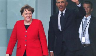 Former US President Barack Obama, right, waves as he and German Chancellor Angela Merkel, left, leave the Chancellery after a meetin in Berlin, Germany, Friday, April 5, 2019. (AP Photo/Michael Sohn)
