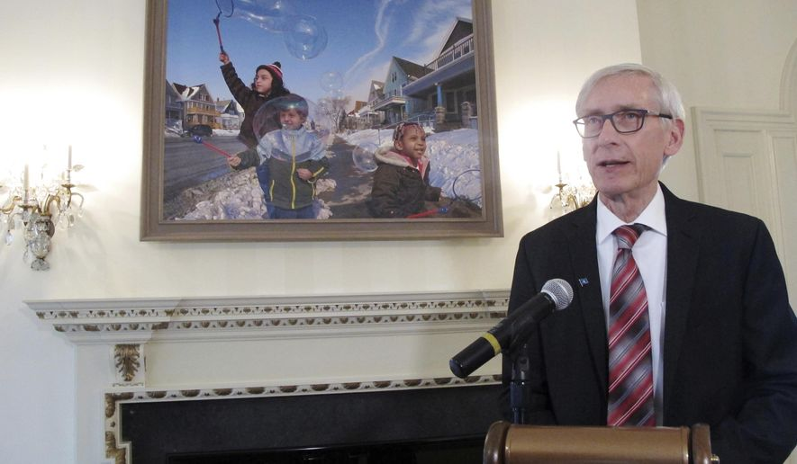 "Wisconsin Gov. Tony Evers discusses the painting ""Wishes in the Wind"" that former Gov. Scott Walker had removed but that Evers had re-installed in the governor's mansion, Friday, April 5, 2019, in Maple Bluff, Wis. (AP Photo/Scott Bauer)"