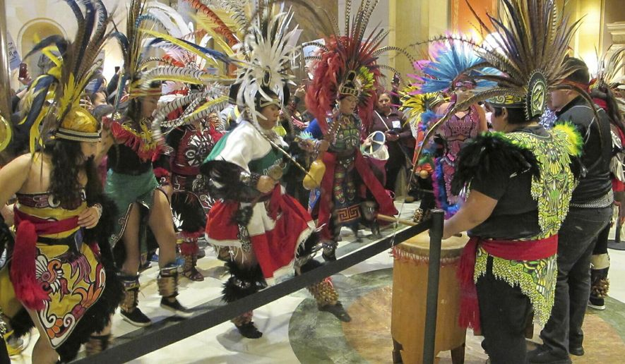 Indigenous Latin American dancers perform outside the chamber of the Minnesota House on Friday, March 5, 2019, as representatives debate a bill that would allow all Minnesota residents to obtain driver's licenses regardless of their immigration status. (AP Photo/Steve Karnowski)