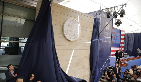 In this May 14, 2018, file photo, U.S. President Donald Trump's daughter Ivanka Trump, left, and U.S. Treasury Secretary Steve Mnuchin unveil an inauguration plaque during the opening ceremony of the new U.S. Embassy in Jerusalem. (AP Photo/Sebastian Scheiner, File)