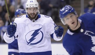 Tampa Bay Lightning right wing Nikita Kucherov (86) celebrates his goal against the Toronto Maple Leafs during the third period of an NHL hockey game in Toronto on Thursday, April 4, 2019. (Nathan Denette/The Canadian Press via AP)