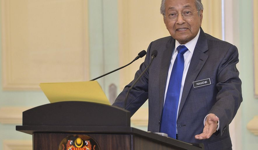 Malaysian Prime Minister Mahathir Mohamad speaks during a press conference at prime minister office in Putrajaya, on Friday, April 5, 2019. Mahathir says Malaysia will withdraw from endorsing another U.N. treaty, caving in to political pressure after a powerful state sultan joined the opposition to oppose the move. (AP Photo/Jeffery Ong)