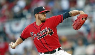 Atlanta Braves starting pitcher Kevin Gausman works against the Miami Marlins in the first inning of baseball game Friday, April 5, 2019, in Atlanta. (AP Photo/John Bazemore)